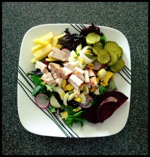 A typical salad for me, on the auto immune disease protocol diet.  Carrots, radishes, pastured eggs, organic chicken, beats, greesn and pickles (Bubbies brand).  YUM.